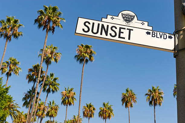 Sunset Boulevard Beverly Hills, CA USA - August 18, 2016: The Beverly Hills section of Sunset Boulevard features some of the nicest homes in Los Angeles County sunset boulevard los angeles stock pictures, royalty-free photos & images