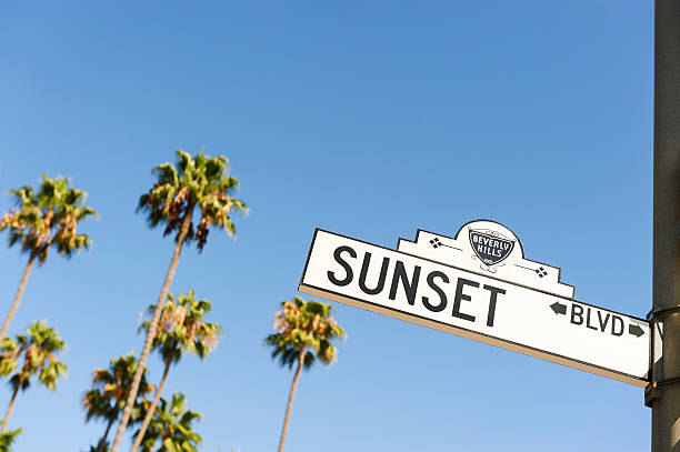 Sunset Boulevard street sign Beverly Hills, CA USA - August 18, 2016: The Beverly Hills section of Sunset Boulevard features some of the nicest homes in Los Angeles County sunset boulevard los angeles stock pictures, royalty-free photos & images