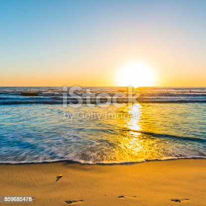 Sunset bright sun sets over the horizon. Beautiful beaches of California. South of the USA