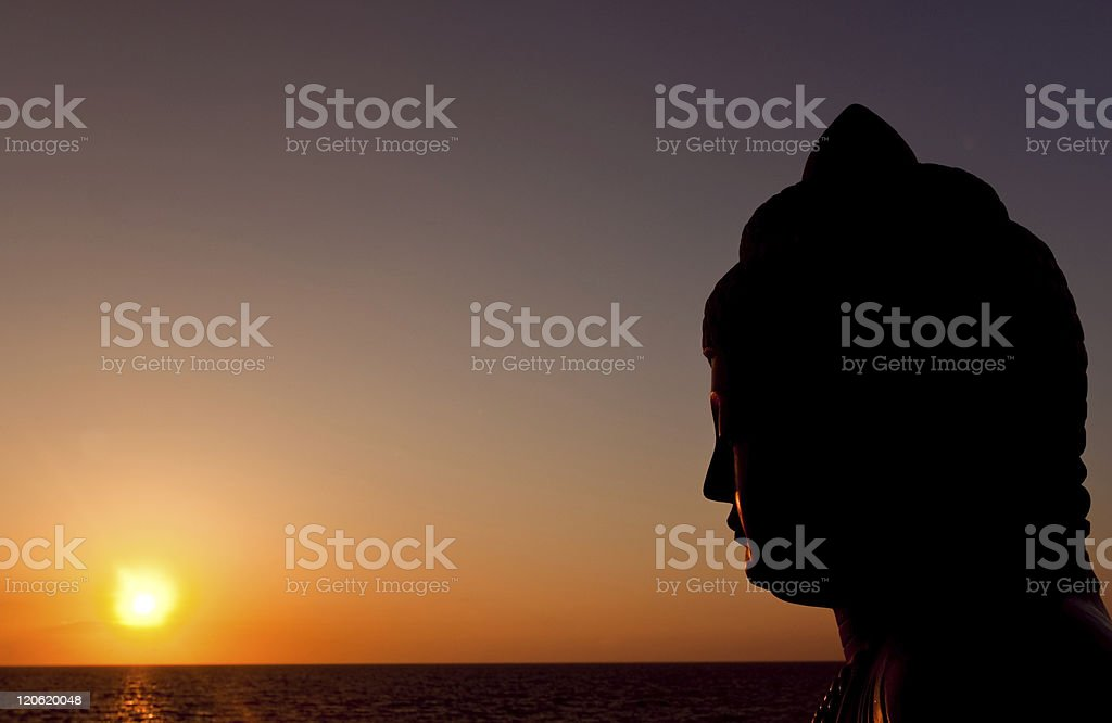 sunset buddha stock photo
