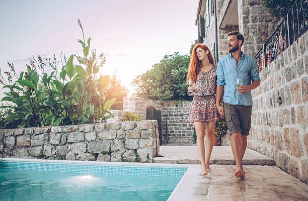 sunset by swimming pool - pool schritte stock-fotos und bilder