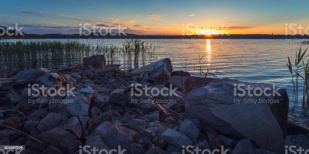 Sunset by the coast stock photo