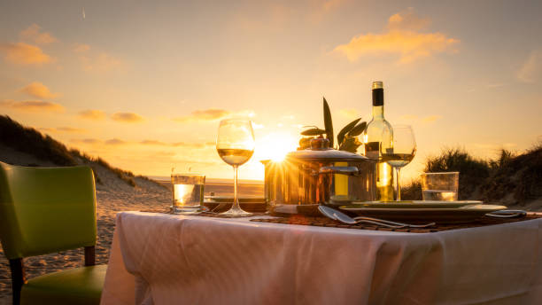 sunset candlelight dinner on the beach stock photo