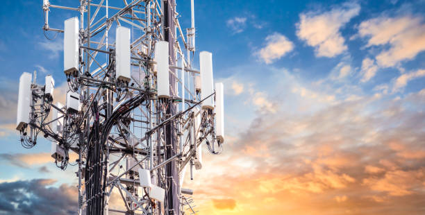5G Sunset Cell Tower: Cellular communications tower for mobile phone and video data transmission 5G Sunset Cell Tower: Cellular communications tower for mobile phone and video data transmission telecommunications equipment stock pictures, royalty-free photos & images