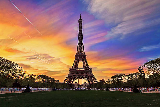 sunset clouds eiffel - eiffel tower stock photos and pictures