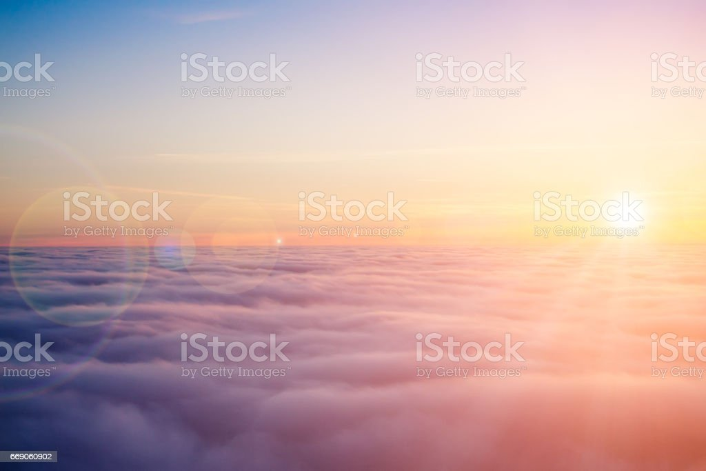 Sunset clouds from above stock photo