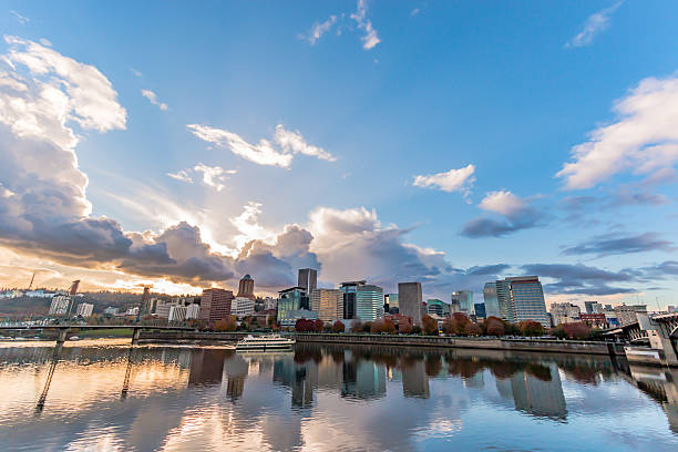 Sunset Clouds Over Downtown Portland Oregon Skyline Brilliant River Reflections stock photo