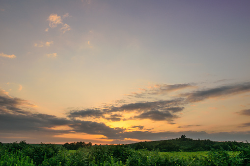 istock Sunset cloudscape and green field in Abkhazia 922760970
