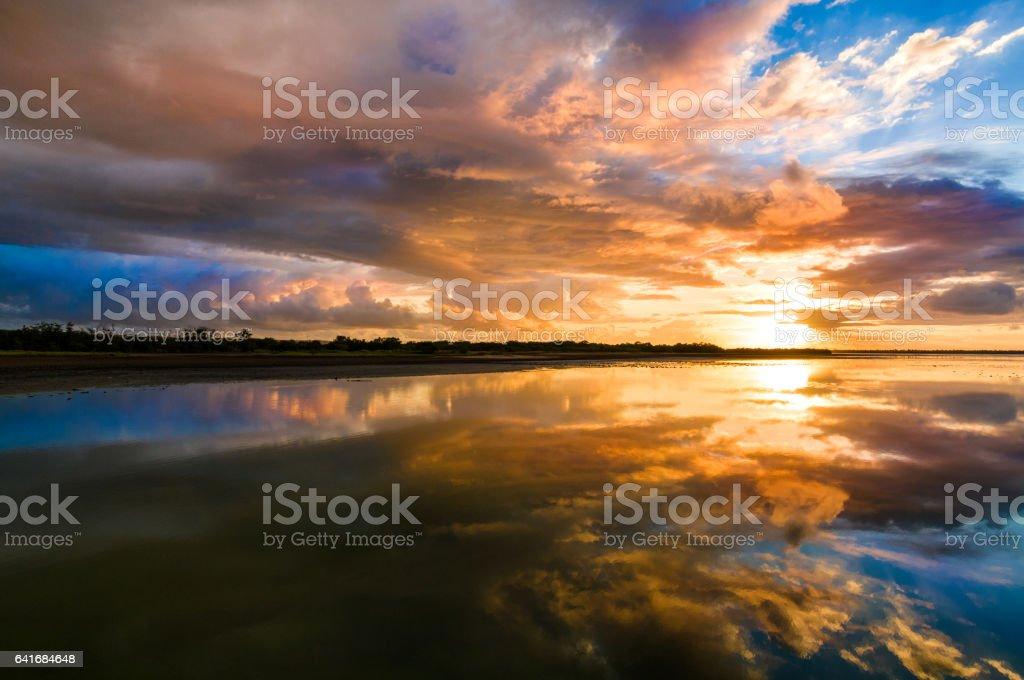 Sunset cloudscape at Caribbean lagoon stock photo