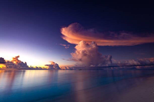 sunset cloudscape maldives islands stock photo