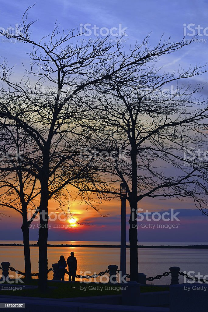 Sunset couple silhouette stock photo
