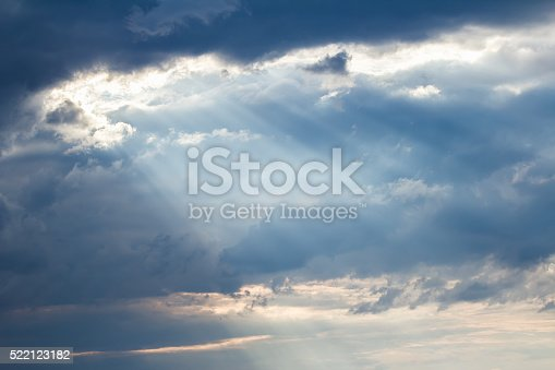 istock Sunset crepuscular rays pouring though scattered clouds 522123182