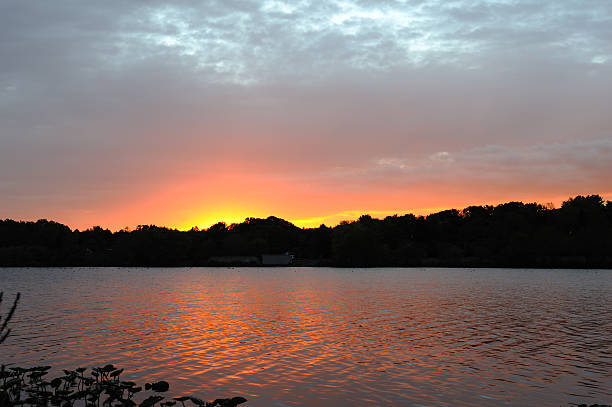 Sunset cross the lake stock photo