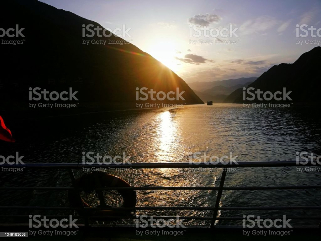 Sun setting over the mountains on the Yangtze River, China