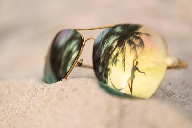 Sunset Dancing, Palm Tree Sunglasses Reflection, Thailand stock photo