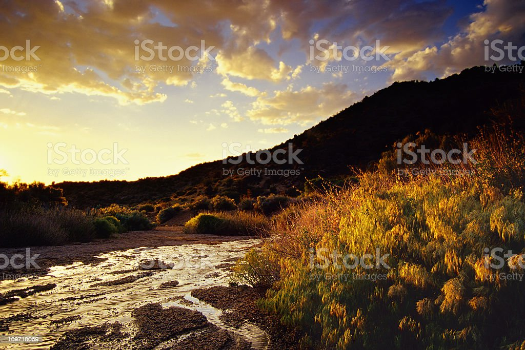 sunset desert mountain landscape stream and sky royalty-free stock photo