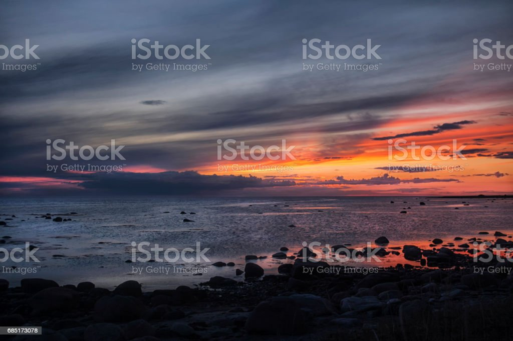 Sunset diverges sun over the sea royalty-free stock photo