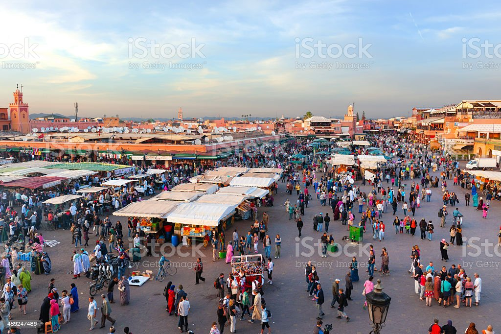 Sunset  Djemaa El Fna Square with Koutoubia Mosque, Marrakech, Morocco stock photo