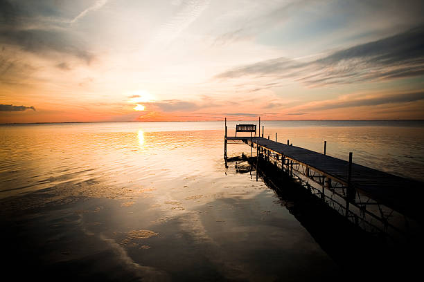 sunset dock - green bay wisconsin stock photos and pictures