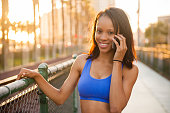istock Sunset Downtown San Diego Active Women On Cell Phone 619670002