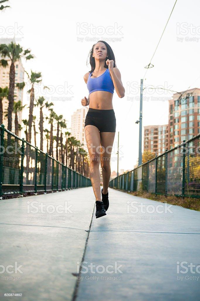 Sunset Downtown San Diego Women Running Low Angle zbiór zdjęć royalty-free