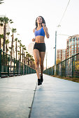 istock Sunset Downtown San Diego Women Running Low Angle 620374852