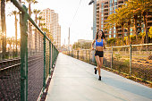 istock Sunset Downtown San Diego Women Running 619644310