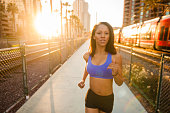 istock Sunset Downtown San Diego Women Running 619652192