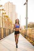 istock Sunset Downtown San Diego Women Running 619657880
