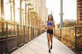 istock Sunset Downtown San Diego Women Running 619661282