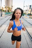 istock Sunset Downtown San Diego Women Running 619986162