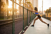 istock Sunset Downtown San Diego Women Stretching 619760260