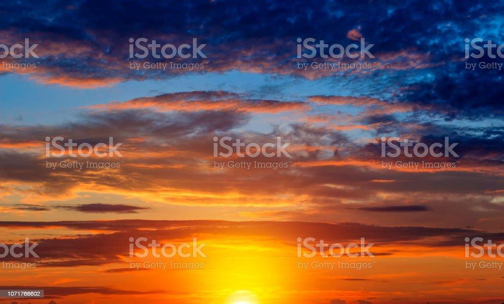 Sunset dramatic sky clouds. Beautiful summer background.