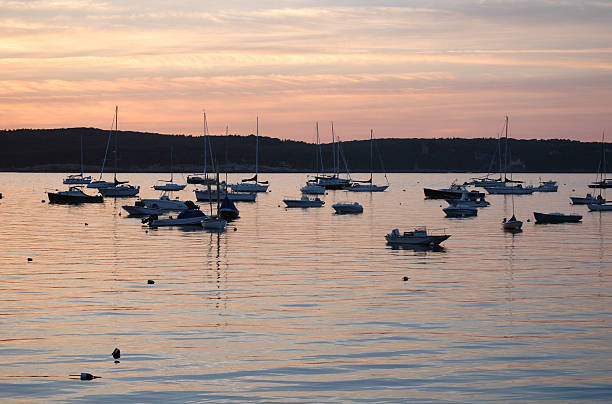 Sunset, Eastern Point, Gloucester, MA Sunset seen from Eastern Point, Gloucester, MA gloucester massachusetts stock pictures, royalty-free photos & images