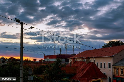 istock Sunset evening sky pink clouds of the roof of the houses of Uzhhorod city, Ukraine 905052122