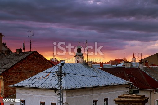 istock Sunset evening sky pink clouds of the roof of the houses of Uzhhorod city, Ukraine 905052160