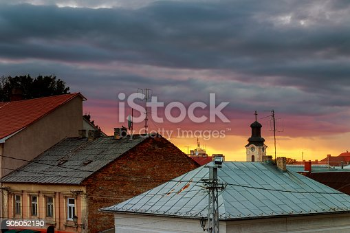 istock Sunset evening sky pink clouds of the roof of the houses of Uzhhorod city, Ukraine 905052190
