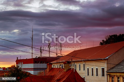 istock Sunset evening sky pink clouds of the roof of the houses of Uzhhorod city, Ukraine 905052208