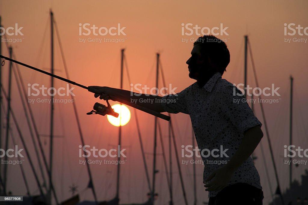 Sunset Fisherman royalty-free stock photo