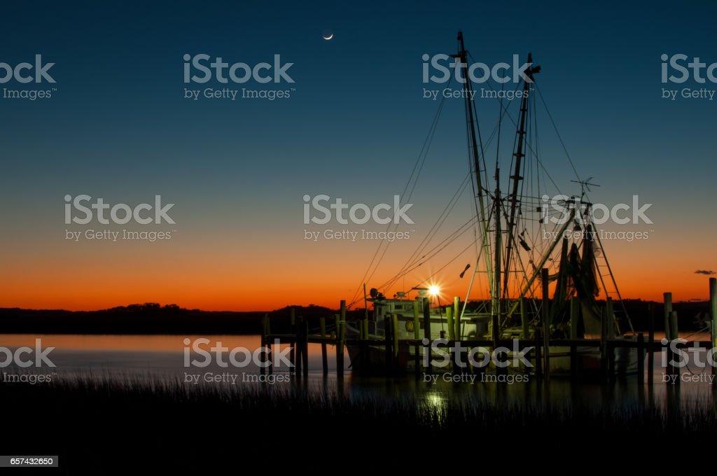 Sunset fishing boat stock photo