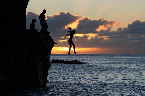 Sunset Freefall  taking the plunge stock pictures, royalty-free photos & images