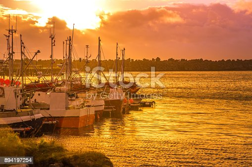 932662672istockphoto Sunset from a harbor in Norway 894197254