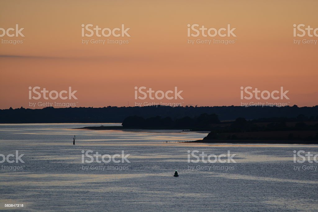 Sunset from a river stock photo