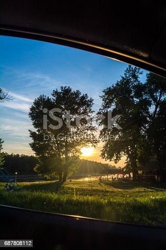 istock Sunset from car window 687808112