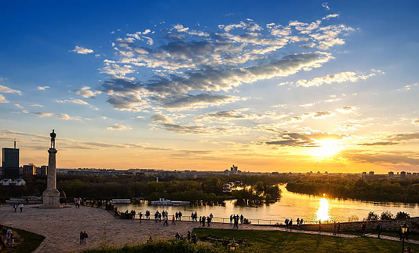 sunset from kalemegdan fortress to confluence of danube and sava - belgrade serbia stock photos and pictures