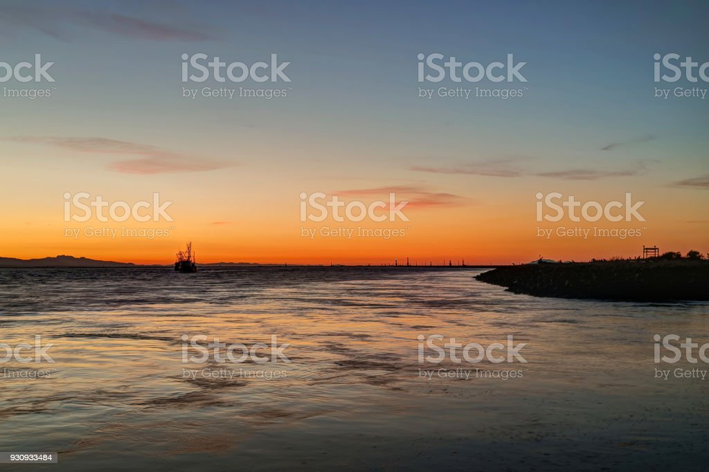 sunset glow over sea water stock photo
