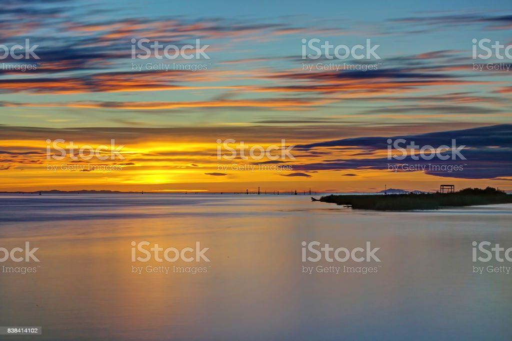 sunset glow with smooth water effect stock photo