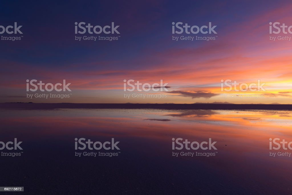 Sunset gradient colour reflection at Uyuni Bolivia stock photo