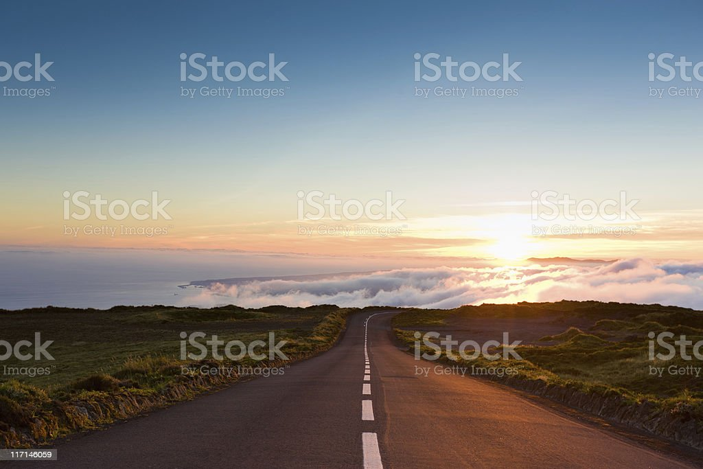 Sunset Highway into the Clouds stock photo