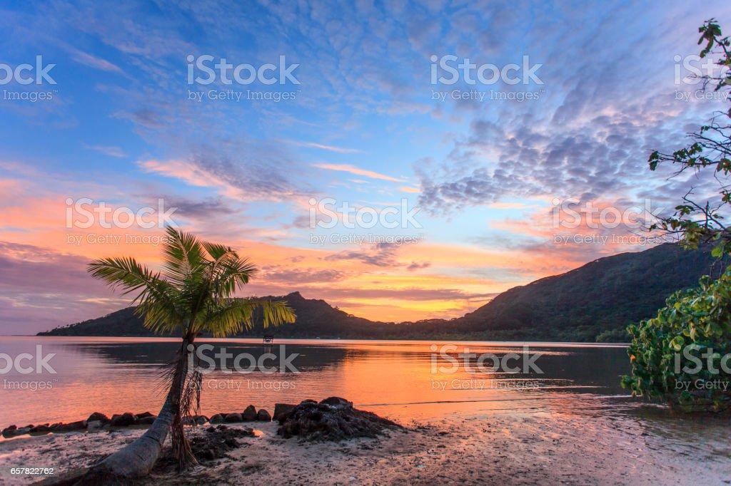 sunset Huahine polynesia stock photo